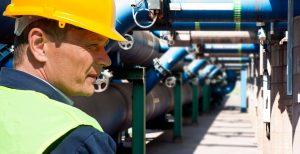 Maintenance engineer overlooking pipes